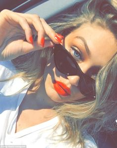 All-American beauty! Gigi Hadid glows as she shows off matching red lip and nails for stunning retro selfie | Daily Mail Online