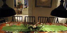 beautifully set table with a banana leaf centre piece - sun house, galle, sri lanka