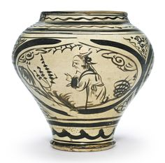 LARGE 'CIZHOU' PAINTED JAR, YUAN DYNASTY, heavily potted, with rounded sides tapering towards a narrow splayed foot, the wide mouth with a short neck and lipped rim, freely painted in dark iron-brown on a creamy-white ground with three large cartouches. H 11 3/4  in.
