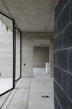Pigment dyed Bessa Block and Mortar, complimented by naturally coloured Plank Formed Concrete walls.