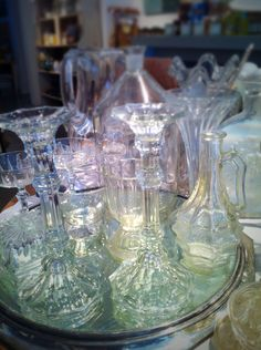 I love antique glass ranging in tones from perfectly clear to the most subtle amethyst or lemon meringue tinges. These glimmers atop a Victorian mirrored tray