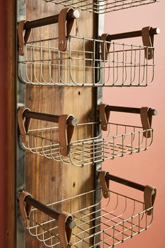 Wall Basket Storage, Baskets On Wall, Baskets For Storage, Wire Baskets, Diy Storage Rack, Hanging Storage, Diy Storage Wall Shelves, Cool Storage Ideas, Diy Clothes Hanger Storage