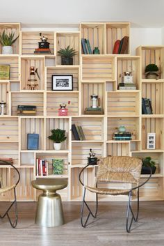 Wooden crates create a simple storage solution when stacked along the wall to create a bookshelf.