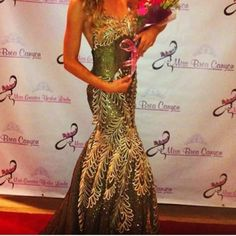 MNM Couture Pageant Gown Wore it for two pageants, pristine condition. Sweet heart top. Black with gold detail. Dresses