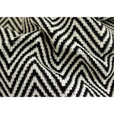 "Heavyweight Op Art Zigzag Woven Home Decorating Cotton (Made in India)  A heavyweight home decorating cotton with a lengthwise zigzag pattern in black and natural - perfect for place-mats or to upholster furniture. Made in India. 100% cotton. 53"" wide."