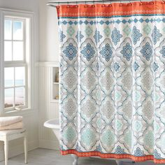 Beautiful formations of floral-inspired flourishes accented by dashes and dots of contrasting color make the Henna Shower Curtain a whimsical addition to your bathroom. The bold print is the perfect accessory to bring color into your powder room.