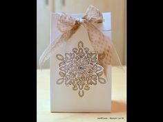 In this video I show you how I made this gift bag, as well as how I threaded the Silver Cord Trim through the top of the bag together with the Dotted Lace Tr...
