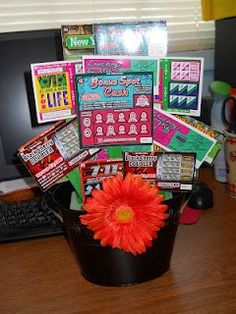 Lottery Ticket Basket, I used a curly bow instead of the flower and put a heart shaped balloon on a stick in the back :)