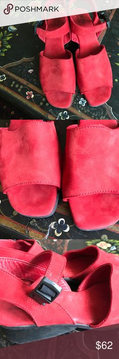 Arche red suede sandals. In excellent used condition. Super comfortable! Elastic bands give some flexibility around the ankles, although the buckle itself is not adjustable. Made in France. The size on the shoe indicates a size 40.5, but I think they run a tad small, so I'm listing them as a size 10. Arche Shoes Sandals