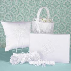 Complete your lace wedding with this collection, including: white lace garters, basket, pillow and guest book. #DavidsBridal #LaceWedding http://www.invitationsbydavidsbridal.com/Wedding-Day-Essentials/Collections--Garters/2947-DBK20570-Sweetly-Smitten-Collection.pro?&sSource=Pinterest&kw=LoveyLace_DBK20570