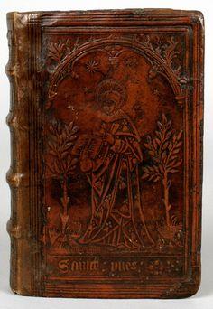 """Reliure à la plaque figurant """"Sainct Yves"""". DATE: 1515."""