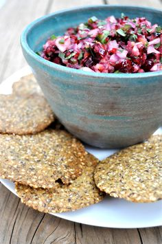 Raw cranberry salsa and chips made with almond flour, seeds and spices.