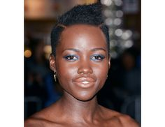 @Byrdie Beauty - The Oscar winning actress might not have a lot of locks to play with, but even moving her part transforms Lupita Nyong'o's look.