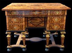 A Louis XIV parcel-gilt walnut, olive-wood, fruitwood and parquetry bureau Mazarin a dessus brisé, France, circa 1700