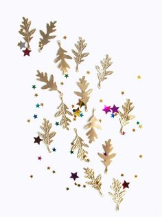 Gold leaves pendants on the blog 53 Countesses: JEWELRY COLLECTION: nos disfrazamos de bosque ♥ we're all leafy over here