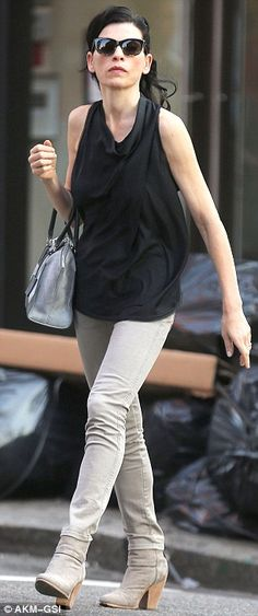 Slim star: The actress showed off her lean limbs in a sleeveless black blouse and grey ski...