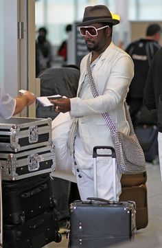"Will.i.am with his Globe-Trotter Centenary Black 21"" Trolley Case"