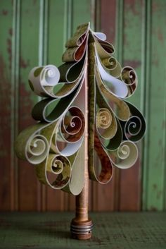 ~ Curley Christmas Tree ~  try vintage book pages  -I wonder if this would work with color swatches... M by firefly332