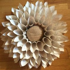 s 17 brilliant ways to reuse your empty cardboard boxes, home decor, repurposing upcycling, Use It to Start a Book Page Wreath