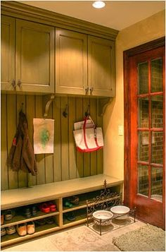 bench with overhead storage.  Back with beadboard and hooks. #laundry