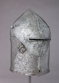 This particular form of helmet, with its two-piece construction, distinctive visor, and hinger flap on one side, is only found among the Chalcis group. Medieval Helmets, Medieval Armor, Ancient Armor, National Historical Museum, Knights Helmet, Armadura Medieval, Arm Armor, Suit Of Armor, Classic Image