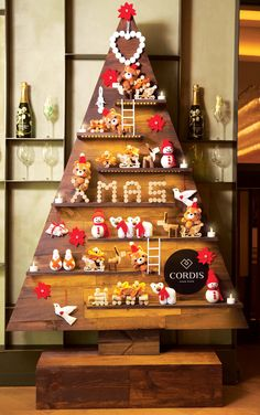 The wooden framework of this tree by Cordis, Hong Kong is made of used wine boxes from by the hotel's wine suppliers. The decorations such as the trains, gift boxes and reindeers are created by recycled wine corks from the hotel's restaurants Ming Court and Alibi. The Snowman ornaments are made with old light bulbs from Housekeeping.