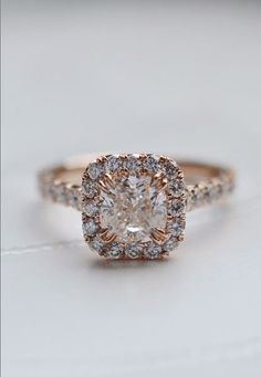 Love this dazzling halo engagment ring in rose gold.