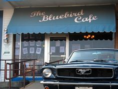 Old Mustang awaits its owner outside the Bluebird Cafe in Nashville