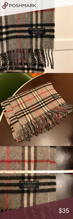 Classic Burberry 100% lambswool scarf Classic 100% lambswool scarf in grey, black and red plaid with fringe by Burberry.  Scarf has been lovingly worn and has a few small holes with the largest shown.  Price is reflective of these issues. Burberry Accessories Scarves & Wraps