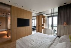 ♥ The bedroom and guest room are kept fairly minimal, though an awesome modern chaise looks out over the city and offers the perfect place to cuddle up with your favorite party partner.