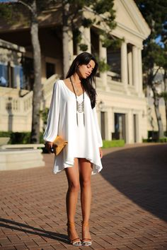 Chiffon loose short dress features a split long sleeve, V-neckline and elastic cuff. It wear very comfortable and fashion, split long sleeve looks even sexy. Wear this special designed short dress wit