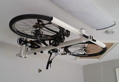 Even for people who have garages, stored bicycles can still get in the way. Thats why Codeima Srl created the flat-bike-lift, which allows users to store their rides flat against the ceiling – with a little pneumatic and hydraulic assistance.