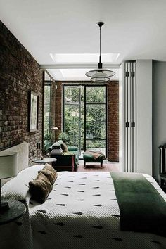 Terrace Bedroom with glass doors - After a complete gut job, interior designer Jane Gowers created a light filled family home - small spaces on HOUSE by House & Garden