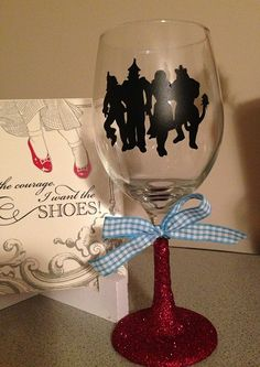 Sher's Note: Wizard of Oz Wine Glass --I cut out Wizard of Oz silhouette and applied to glass, used modge pod & glitter with sealer --added bow and VIOLA! :) http://pinterest.com/SherSher12/