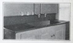 Stone counters! A suggested use for a slate sink, set on top of cabinets, from 1921 Structural Slate Co. catalog.