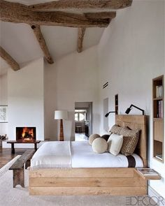 Design Chic: Bedding for the Ages  ++wooden bed and headboard, floor lamp, beams.MPS