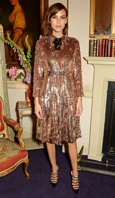 Alexa Chung in a rose gold sequin Gucci dress