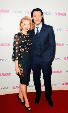 Sarah Gadon and Luke Evans in Giorgio Armani three piece navy suit at 2014 Glamour Women Of The Year Awards http://www.whats-he- wearing.com/2014/06/uke-evans-in-giorgio-armani-2014-glamour-women-of-the-year-awards.html  Love the man's look