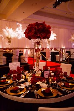 Love how the centerpiece is gets bigger higher up.  Isn't in the way of guests' seeing each other