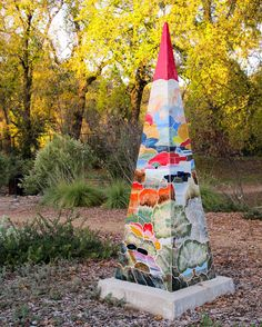 27. One of two 7 foot ceramic pyramids depicting regional scenery created by local artist Paul Rideout for the Arboretum. They reflect his impressions of such north state sights as the Millville Plains, Mt. Shasta, waterfalls, the Sundial Bridge and native oaks.  Very nice.