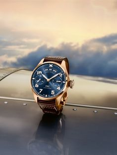 """Discover the IWC Big Pilot's Watch Annual Calendar Edition """"le Petit Prince"""". Together with the red gold of the case, hands and appliqués, the shimmering midnight blue of the dial underscores its exclusive character."""