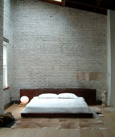 A minimal, low-profile headboard is great for industrial lofts and condos.