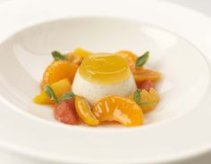 This is a light panna cotta made using a combination of milk and cream. The infusion of vanilla and cardamom in the panna cotta marries with the citrus fruits and basil creating a simple aromatic and fresh dessert which can be made ahead of time.