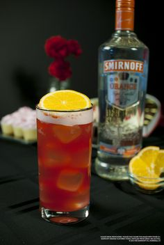Crushed Orange with 1.5 oz SMIRNOFF® Orange Flavored Vodka, 2 oz pineapple juice, 2 oz cranberry juice and 1 slice orange. Fill glass with ice. Add SMIRNOFF® Orange Vodka, pineapple juice, and cranberry juice. Stir well. Garnish with orange slice. #Smirnoff  #Drink #Recipe #ValentinesDay