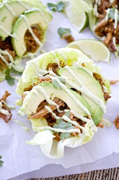 A fun recipe that uses my slow cooker chipotle pulled pork! Stuff the pork into lettuce wraps, top with sliced avocado and drizzle with the most delicious aioli.    {This recipe is dairy-free, gluten-free, Paleo, and Whole30}