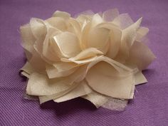 Great way to make a fabric flower to add to your dress. I'd choose using a crystal brooch for the center.