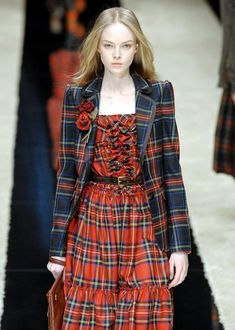 I'm still not sure why models have to look just this side of death (and crabby about it), but the tartan is great. Tartan Plaid, Mode Tartan, Tartan Dress, Tartan Fashion, Love Fashion, Autumn Fashion, Womens Fashion, Fashion Design, Style Fashion