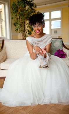 This beautiful ball gown wedding dress is accentuated with a tulle overlay over the bodice.