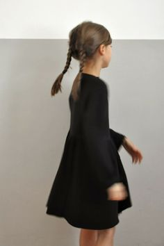 Cerise porte la robe noire Norry, Album di Famiglia