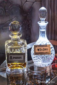 How To Make Elegant DIY Halloween Bottle Labels What an awesome Halloween decorating idea! DIY Halloween bottle labels made with faux silver leaf. I love how they look on these decanters.an elegant way to dress up bottles for a Halloween party. Disney Halloween, Spooky Halloween, Halloween Haunted Houses, Spirit Halloween, Halloween Party, Halloween 2018, Women Halloween, Halloween Crafts, Classy Halloween Wedding